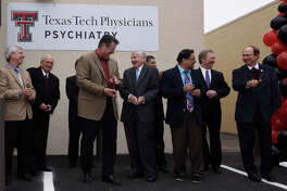 Dr. Tedd Mitchell, Texas Tech Health Sciences Center President (center left) and State Representative Tom Craddick (center right) participate in the grand opening celebration of the Texas Tech Physicians Psychiatric Clinic, a mental health facility funded by the Midland Development Corporation and the Scharbauer Foundation, Nov. 8, 2018. James Durbin/Reporter-Telegram