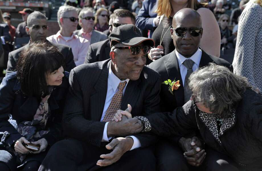 Deb Perry, wife of Gaylord Perry, right, reaches over to shake hands with Willie Mays during a public remembrance for Willie McCovey at AT&T Park in San Francisco, Calif., on Thursday, November 8, 2018. Photo: Carlos Avila Gonzalez / The Chronicle / ONLINE_YES