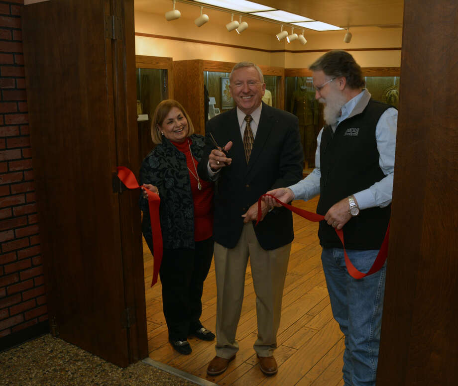 Wayland Baptist University trustee Dr. Less Griffin (center) is joined by former Director of the Museum of the Llano and Elva Hipolito, administrative assistant of the museum, to cut the ribbon on a new WWI exhibit. Photo: Courtesy Photo/Wayland Baptist University