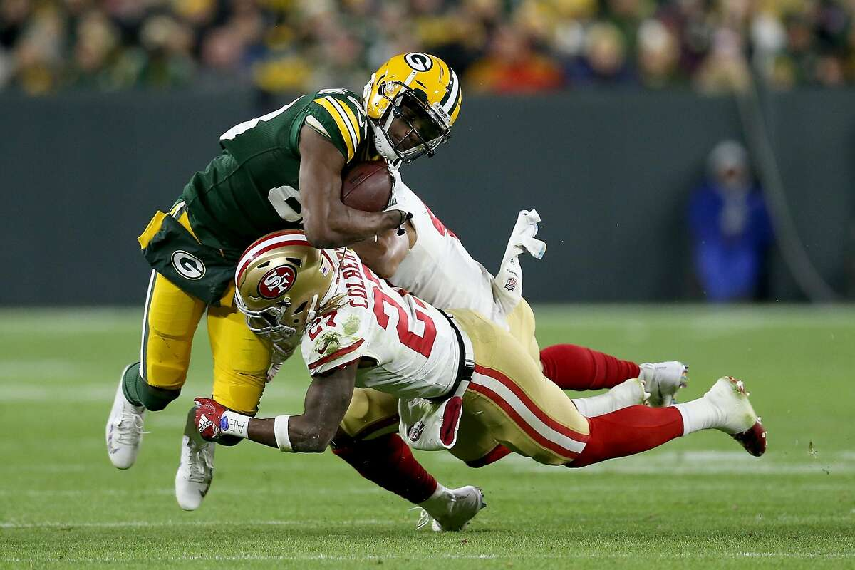 GREEN BAY, WI - OCTOBER 15: Marquez Valdes-Scantling #83 of the Green Bay Packers runs with the ball against Fred Warner #48 and Adrian Colbert #27 of the San Francisco 49ers in the fourth quarter at Lambeau Field on October 15, 2018 in Green Bay, Wisconsin. (Photo by Dylan Buell/Getty Images)