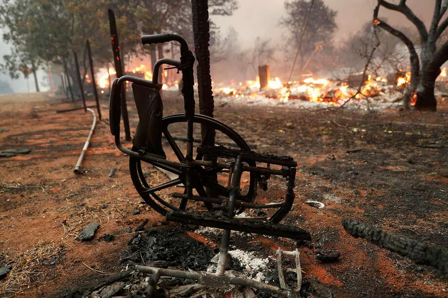 A wheelchair charred by the 2018 Camp fire lies next to a destroyed senior center in the town of Paradise. The majority of the 86 people killed in and around Paradise were senior citizens. Photo: Scott Strazzante / The Chronicle 2018
