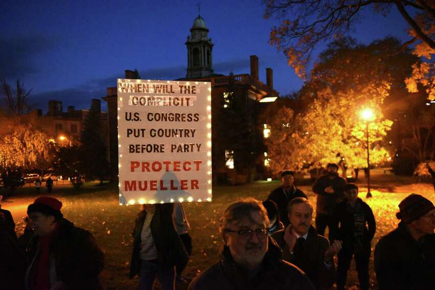 People protest in Lafayette Park against the possibility of Trump and his acting Attorney General Matthew Whitaker firing Robert Mueller on Thursday, Nov. 8, 2018 in Albany, N.Y. (Lori Van Buren/Times Union)