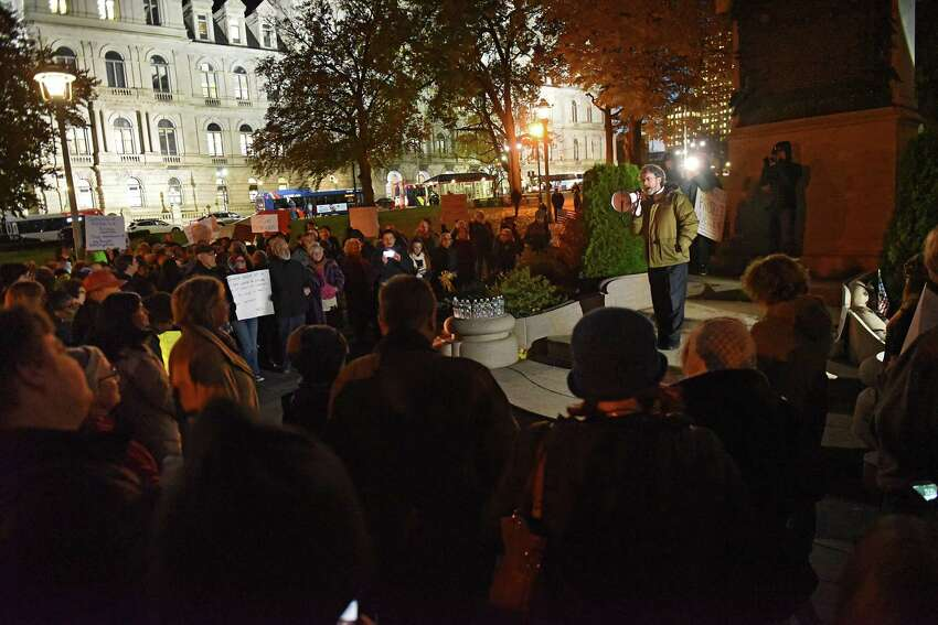 Attorney Mark Mishler speaks as people protest in Lafayette Park against the possibility of Trump and his acting Attorney General Matthew Whitaker firing Robert Mueller on Thursday, Nov. 8, 2018 in Albany, N.Y. (Lori Van Buren/Times Union)