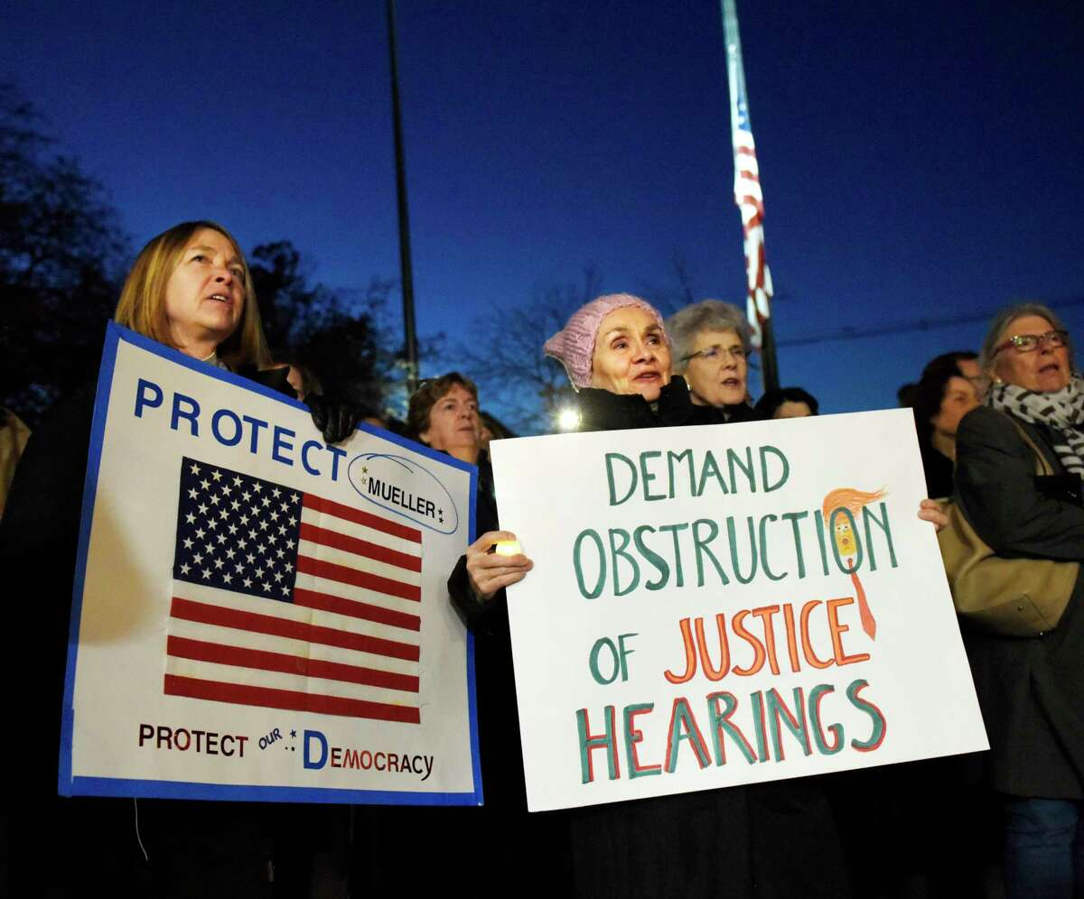 """Redding's Laurie Heiss, left, and Greenwich's Jenny Hille sing """"This Land Is Your Land"""" during the Indivisible Greenwich rally against the firing of Attorney General Jeff Sessions outside Town Hall in Greenwich, Conn. Thursday, Nov. 8, 2018. Indivisible Greenwich, a group """"dedicated to fighting the anti-democratic actions and policies of the Trump Administration,"""" claims President Trump crossed a line by firing Jeff Sessions and potentially interfering with the Mueller investigation. The rally in Greenwich was one of 14 in Connecticut and about 900 nationally."""