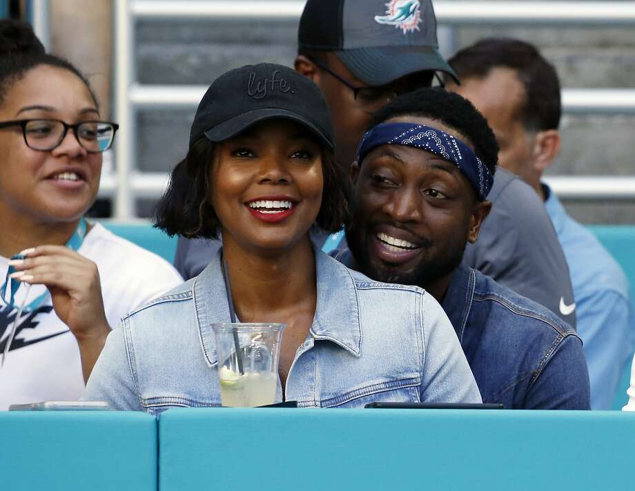 FILE - In this Sunday, Oct. 14, 2018 file photo, Miami Heat player Dwyane Wade and his wife Gabrielle Union-Wade acknowledge the cheers from the crowd during the second half of an NFL football game between the Miami Dolphins and the Chicago Bears in Miami Gardens, Fla. Miami Heat star Dwyane Wade and his wife Gabrielle Union-Wade have a baby. The couple on Thursday, Nov. 8, 2018 announced they've welcomed a baby girl into the world. (AP Photo/Joel Auerbach, File) Photo: Joel Auerbach, Associated Press