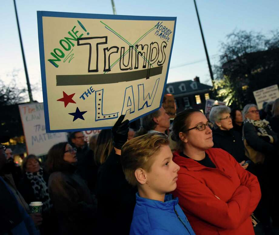 """Photos from the Indivisible Greenwich rally against the firing of Attorney General Jeff Sessions outside Town Hall in Greenwich, Conn. Thursday, Nov. 8, 2018. Indivisible Greenwich, a group """"dedicated to fighting the anti-democratic actions and policies of the Trump Administration,"""" claims President Trump crossed a line by firing Jeff Sessions and potentially interfering with the Mueller investigation. The rally in Greenwich was one of 14 in Connecticut and about 900 nationally. Photo: Tyler Sizemore, Hearst Connecticut Media / Greenwich Time"""