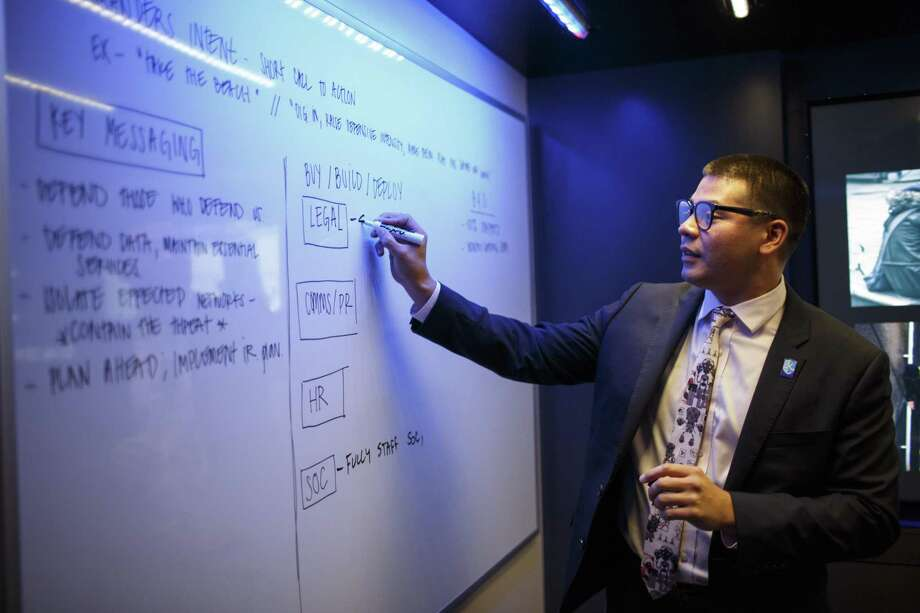 Ben Poernomo, the CTOC Director of Operations with IBM Security, working during a training session simulating a cyber attack on a fictional organization inside the IBM Security X-Force Command training truck in Austin, Tx. on October 23, 2018. Photo: Spencer Selvidge / Spencer Selvidge For The Houston Chronicle / Copyright Spencer Selvidge 2018