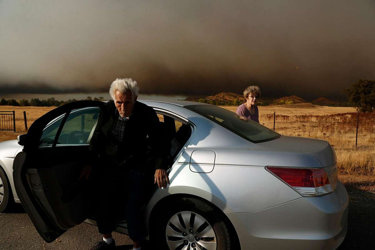 Jim and Irene Cooper get out of their vehicle after evacuating from Paradise during Camp Fire in Butte County, Calif.. on Thursday, November 8, 2018.