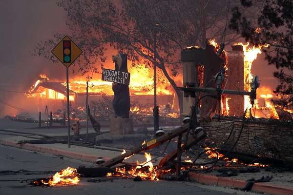 Businesses burn in downtown Paradise during Camp Fire in Butte County, Calif.. on Thursday, November 8, 2018.