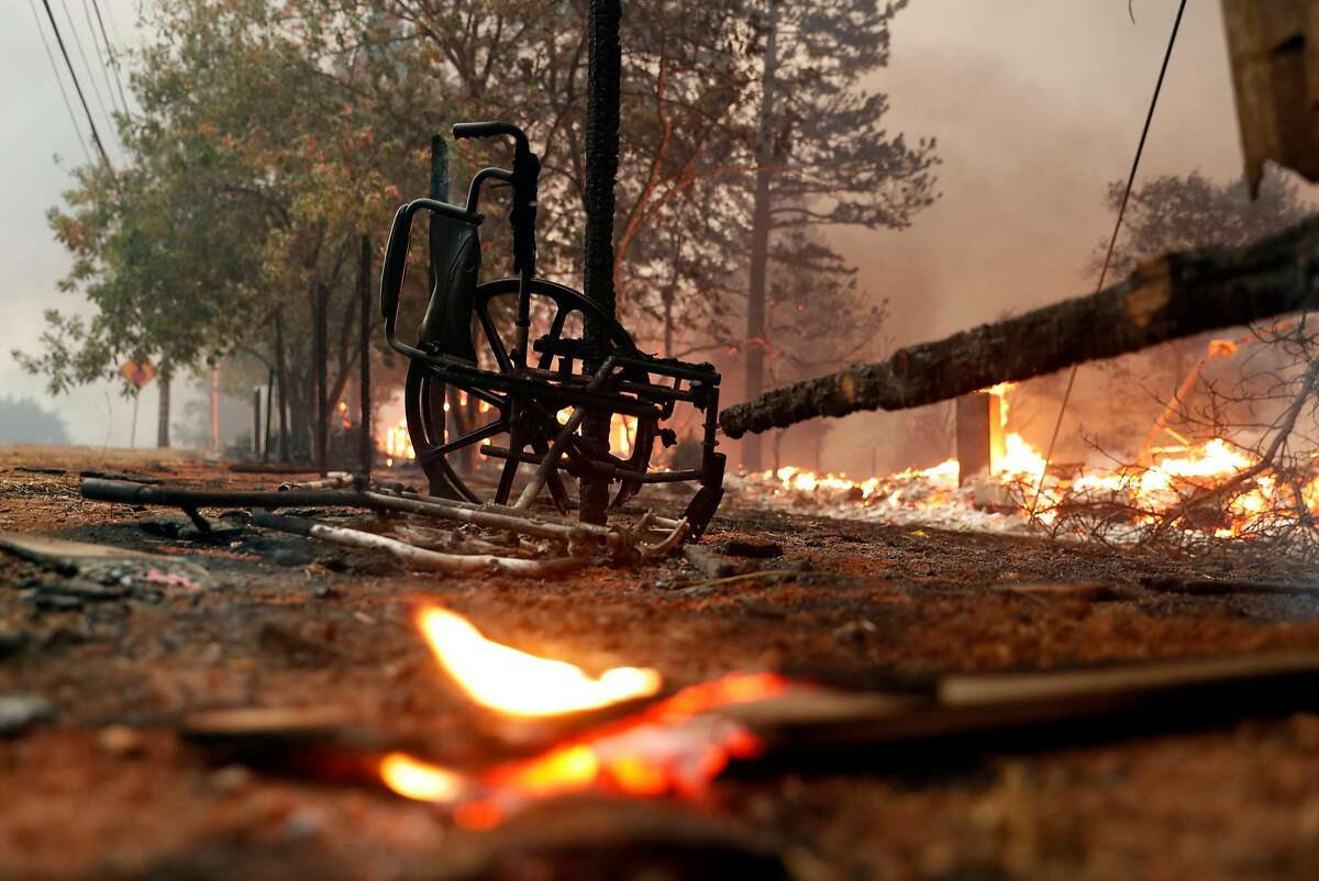 A charred wheelchair in Paradise Gardens senior community during Camp Fire in Paradise, Calif.. on Thursday, November 8, 2018.