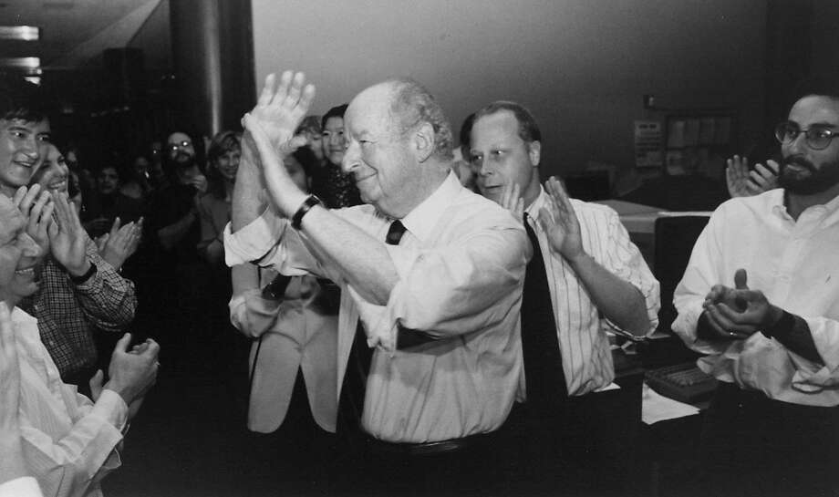 Herb Caen accepts the applause of his colleagues in The Chronicle's newsroom after winning a special Pulitzer Prize on April 9, 1996. Photo: Lea Suzuki / The Chronicle 1996