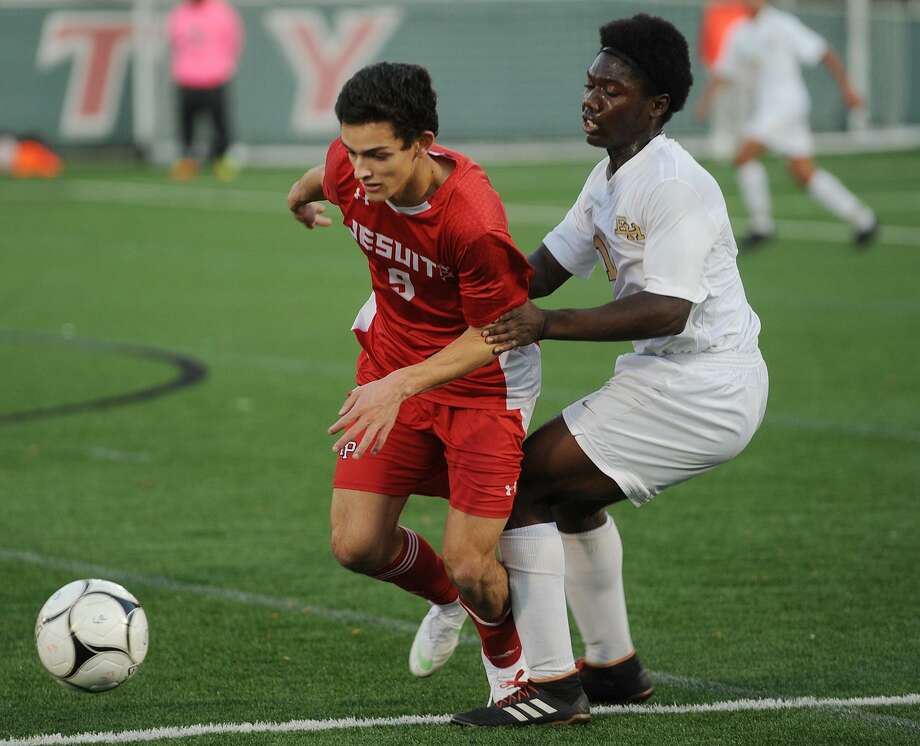 Fairfield Prep's Axel Whamond is held by East Hartford's Garvans Pamphile during their second round game in the Class LL boys soccer playoffs at Fairfield University in Fairfield, Conn. on Thursday, October 8, 2018. Photo: Brian A. Pounds / Hearst Connecticut Media / Connecticut Post