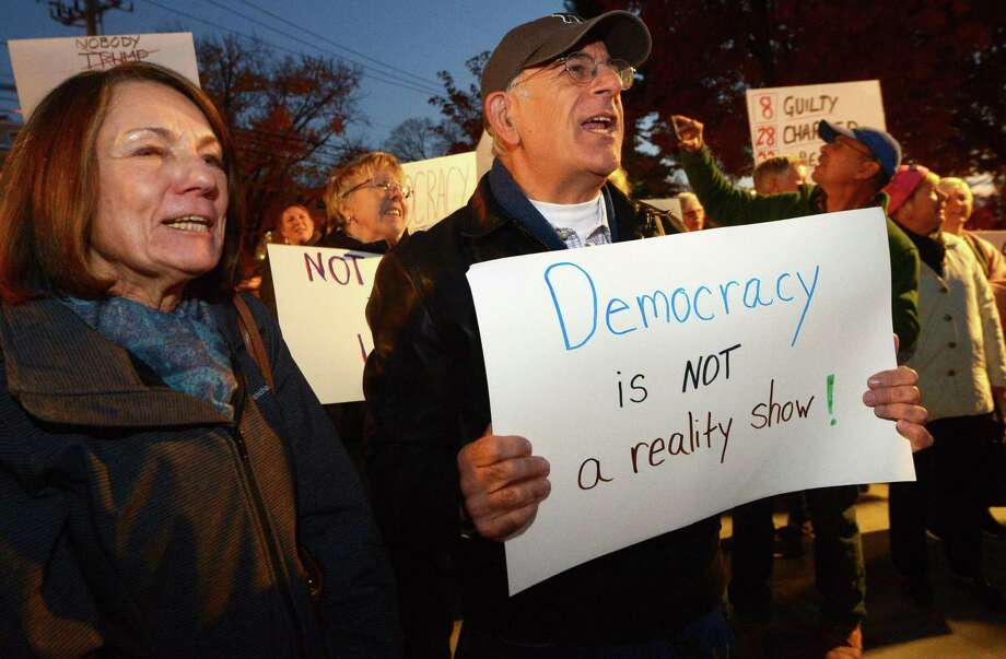 Protesters including Joe and Eileen Carbonara of Fairfield chant as they gather at Norwalk Town Green Thursday, Novemer 8, 2018, in Norwalk, Conn. MoveOn.org organized a nationwide protest against the firing of Attorney General Jeff Sessions y President Donald Trump. Photo: Erik Trautmann / Hearst Connecticut Media / Norwalk Hour