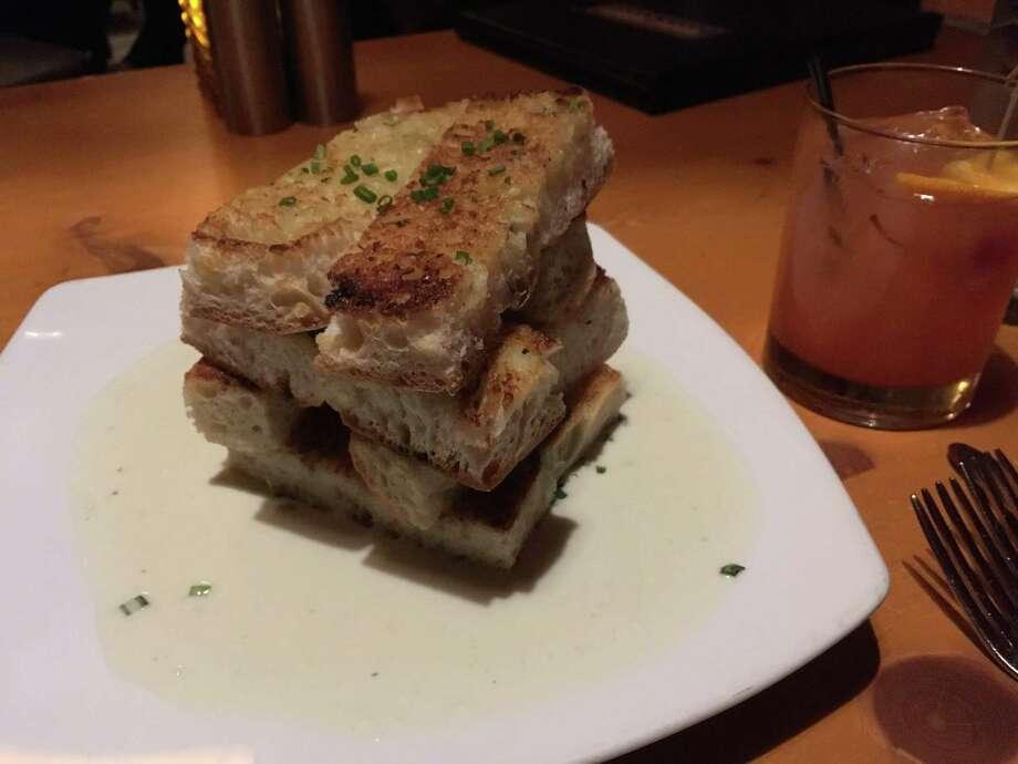 Garlic bread with Maytag blue cheese fondue ($10). Photo: Joe Amarante / Hearst Connecticut Media