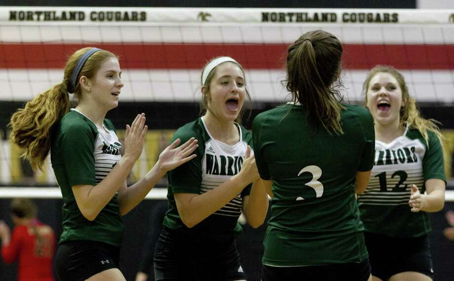 Macie Draudt (14), Abigail Adams (6) and Katherine Tucker (12) of The Woodlands Christian Academy react after an ace by Reese Ray (3) during the first set of a TAPPS District 7-4A high school volleyball match at Northland Christian School, Tuesday, Oct. 16, 2018, in Houston. Photo: Jason Fochtman, Houston Chronicle / Staff Photographer / © 2018 Houston Chronicle