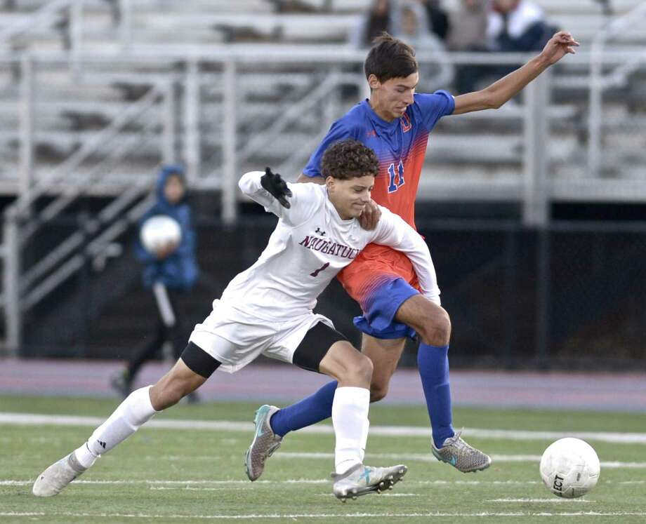 Naugatuck's Saul Pujols (1) and Danbury's Tiago DosReis (11) fight for the ball in the Class LL boys soccer game between Naugatuck and Danbury high schools, Thursday afternoon, November 8, 2018, at Danbury High School, Danbury, Conn. Photo: H John Voorhees III / Hearst Connecticut Media / The News-Times