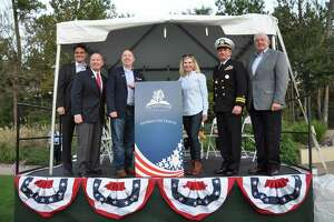 The Woodlands Township will host the 2018 Veterans Day memorial celebration at 4:30 p.m., Sunday, Nov. 11. In this 2017 file photograph, townshop board Vice Chairman John McMullan, U.S. Rep. Kevin Brady, township Directors John Anthony Brown and Ann Snyder, Retired Lt. Cmdr. Charles Abell of the U.S. Navy and Township Director Bruce Rieser honored veterans of all military branches at the Veterans Day Tribute at Town Green Park Saturday, Nov. 11, 2017.
