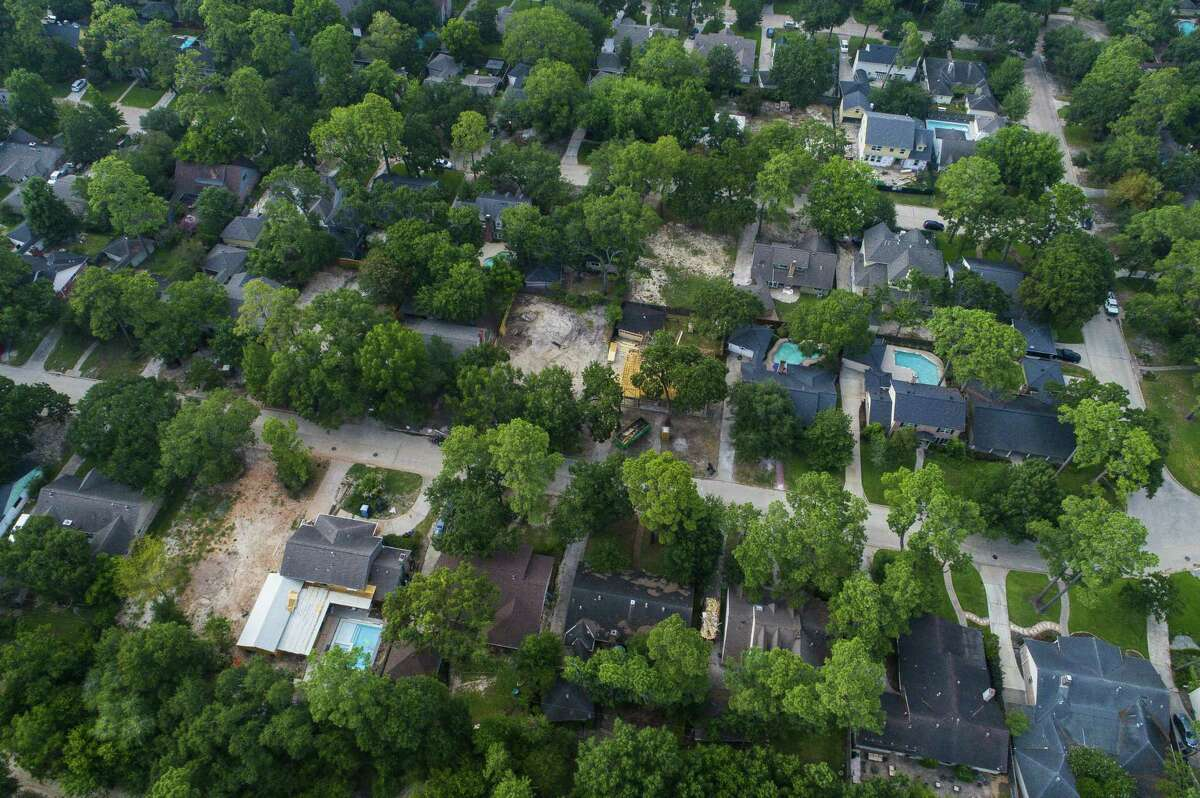 Empty lots are now scattered throughout the Nottingham Forest area near Buffalo Bayou where homes that were flooded during Harvey have been demolished, Friday, July 27, 2018 in Houston. Many of the homes in the neighborhood were still unoccupied a year after floodwater inundated blocks of homes along the bayou. Houses in the neighborhood are in various states of rebuilding - some being remodeled, some completely demolished, some being raised and some simply sitting vacant.