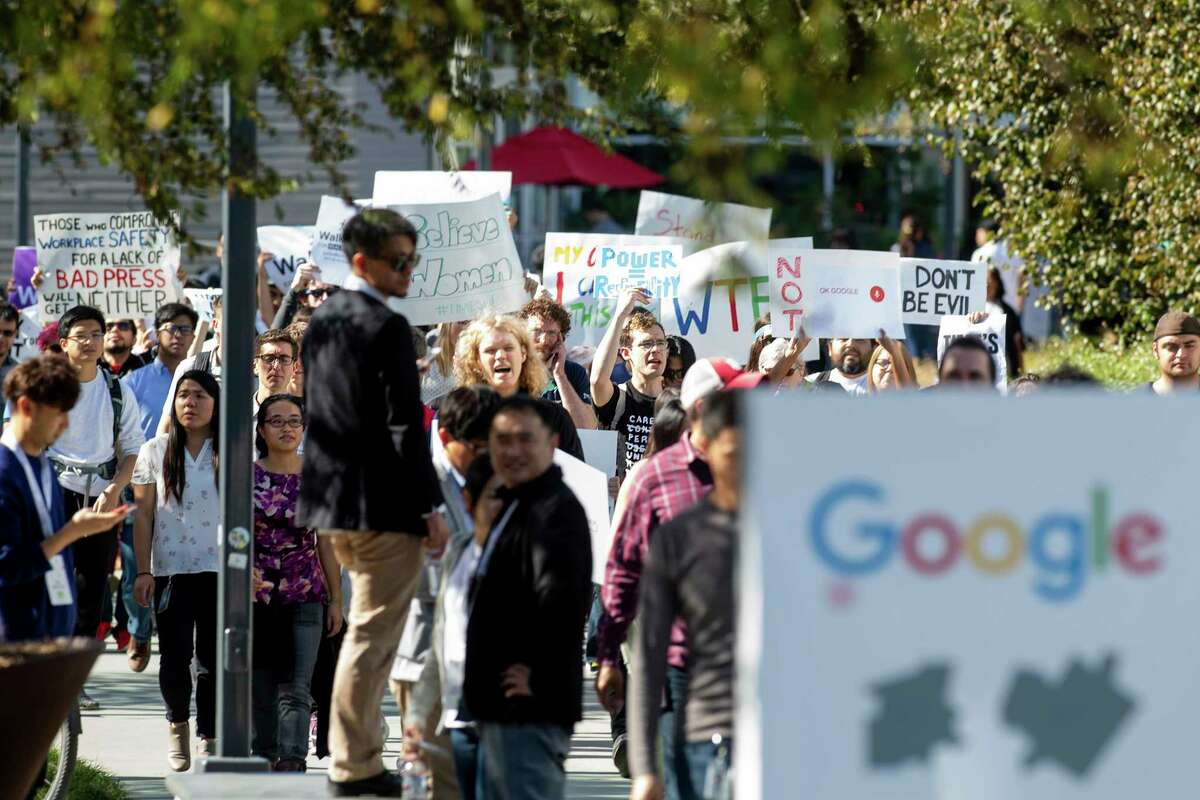 FILE- In this Nov. 1, 2018, file photo, workers protest against Google's handling of sexual misconduct allegations at the company's Mountain View, Calif., headquarters. Google is promising to be more forceful and open about its handling of sexual misconduct cases, a week after high-paid engineers and others walked out in protest over its male-dominated culture. CEO Sundar Pichai spelled out the concessions in an email sent Thursday, Nov. 8, to Google employees. (AP Photo/Noah Berger, File)
