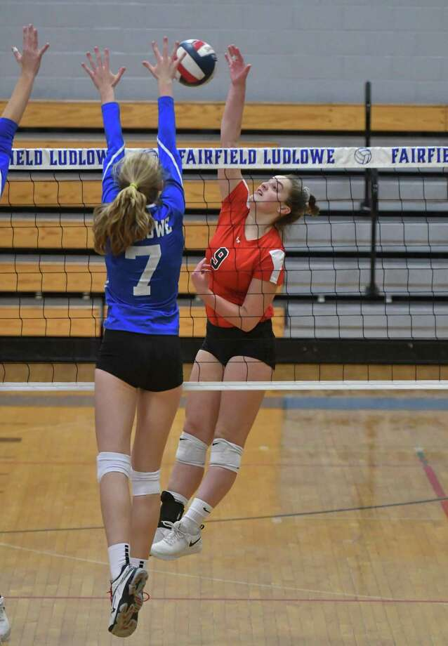 Lillian Saleeby (9) of the Greenwich Cardinals hits a kill shot during the second round of the CIAC tournament against the Fairfield Ludlowe Falcons on Thursday November 8, 2018, at Fairfield Ludlowe High School in Fairfield, Connecticut. Photo: Gregory Vasil / For Hearst Connecticut Media / Connecticut Post Freelance