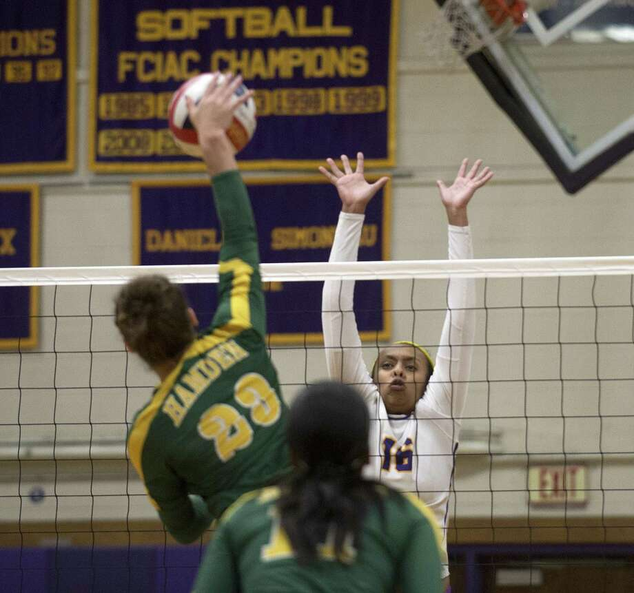 Hamden's Maya Epps spikes the ball as Westhill's Tamar Bellete blocks during Thursday's Class LL volleyball game in Stamford, Conn., on November 8, 2018. Photo: Lindsay Perry / For Hearst Connecticut Media / Stamford Advocate Freelance