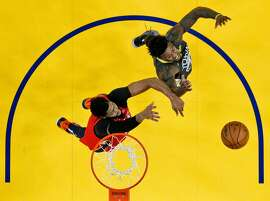 Jordan Bell (2) and Anthony Davis (23) go up for a rebound in the first half as the Golden State Warriors played the New Orleans Pelicans at Oracle Arena in Oakland, Calif., on Wednesday, October 31, 2018.