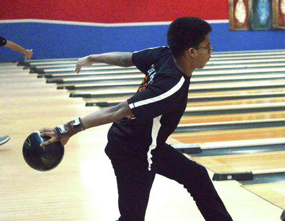 Edwardsville junior Eian Sims bowls on Thursday at Bel-Air Bowl in Belleville during the second day of the Southwestern Conference Tournament.