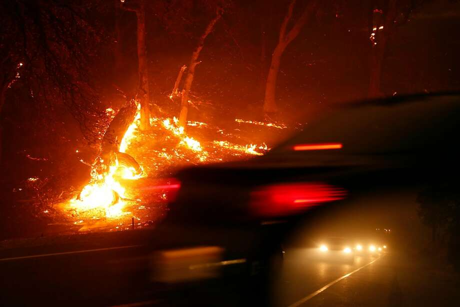 A line of cars evacuate on Hwy. 191 during Camp Fire in Paradise, Calif.. on Thursday, November 8, 2018. Photo: Scott Strazzante / The Chronicle