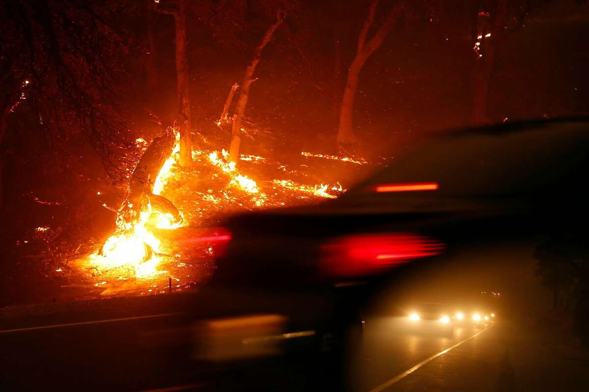 A line of cars evacuate on Hwy. 191 during Camp Fire in Paradise, Calif.. on Thursday, November 8, 2018.
