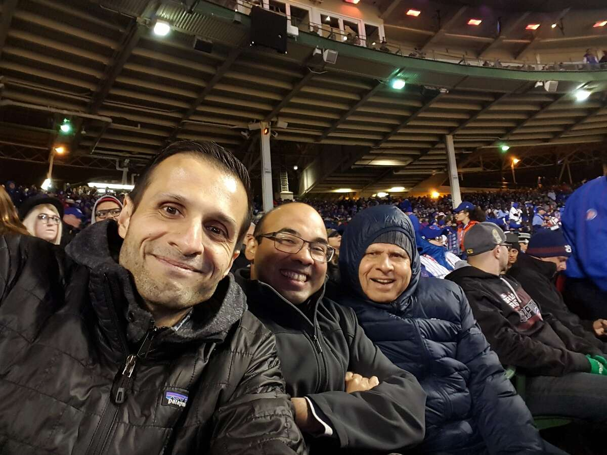 Jaffer and Farhan Zaidi with their father, Sadiq, right, at a Dodgers game at Wrigley Field in April, 2017.