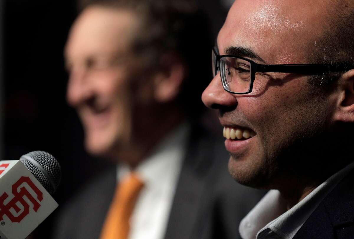 Farhan Zaidi smiles as Giants CEO Larry Baer introduced him as the new president of baseball operations during a press conference at AT&T Park, in San Francisco, Calif., on Wednesday, November 7, 2018.