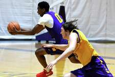 Xavier Cochran, left, is pursued by Brent Hank, right, during a University at Albany men's basketball practice at SEFCU Arena on Monday, Oct. 9, 2017, in Albany, N.Y. (Will Waldron/Times Union)