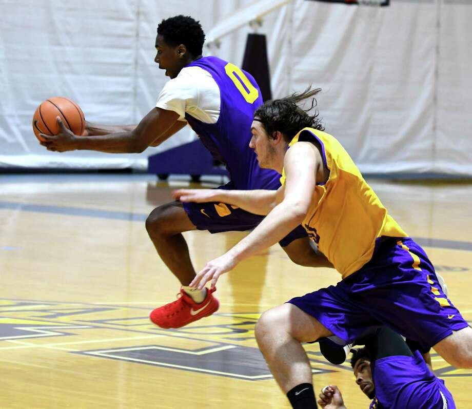 Xavier Cochran, left, is pursued by Brent Hank, right, during a University at Albany men's basketball practice at SEFCU Arena on Monday, Oct. 9, 2017, in Albany, N.Y. (Will Waldron/Times Union) Photo: WILL WALDRON / 20041794A