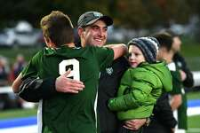 Schalmont's Gabe Comenzo, left, hugs head coach Vito Urbano after defeating Ichabod Crane in the Class B boys' soccer final in overtime on Monday, Oct. 29, 2018 in Troy, N.Y. (Lori Van Buren/Times Union)