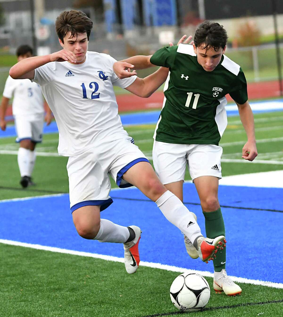 Ichabod Crane's Joe Desmonie, left, battles for the ball with Schalmont's Ryan Edwards during the Class B boys' soccer final on Monday, Oct. 29, 2018 in Troy, N.Y. (Lori Van Buren/Times Union)