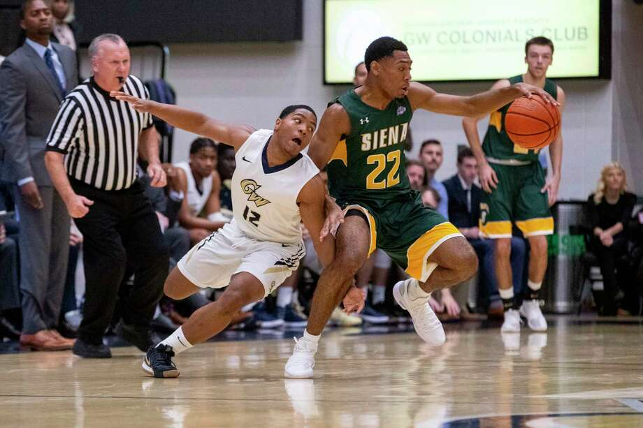 Siena's Jalen Pickett, right, controls the ball in front of George Washington's Shandon Brown during their nonconference game on Thursday, Nov. 9, 2018. Photo: Ethan Stoler, Ethan Stoler / George Washington University / © Ethan Stoler Media
