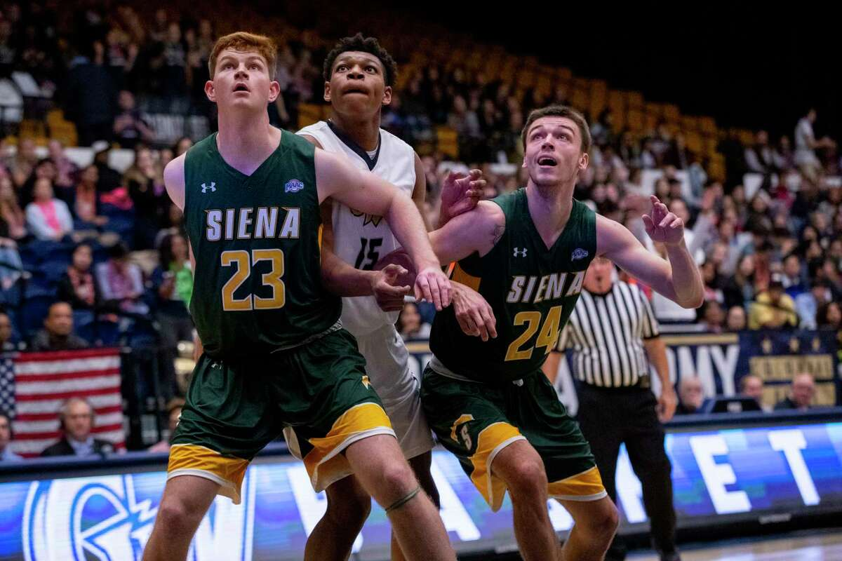 Siena's Sloan Seymour and Jimmy Ratliff box out George Washington's Mezie Offurum during their nonconference game on Thursday, Nov. 9, 2018, at George Washington University.