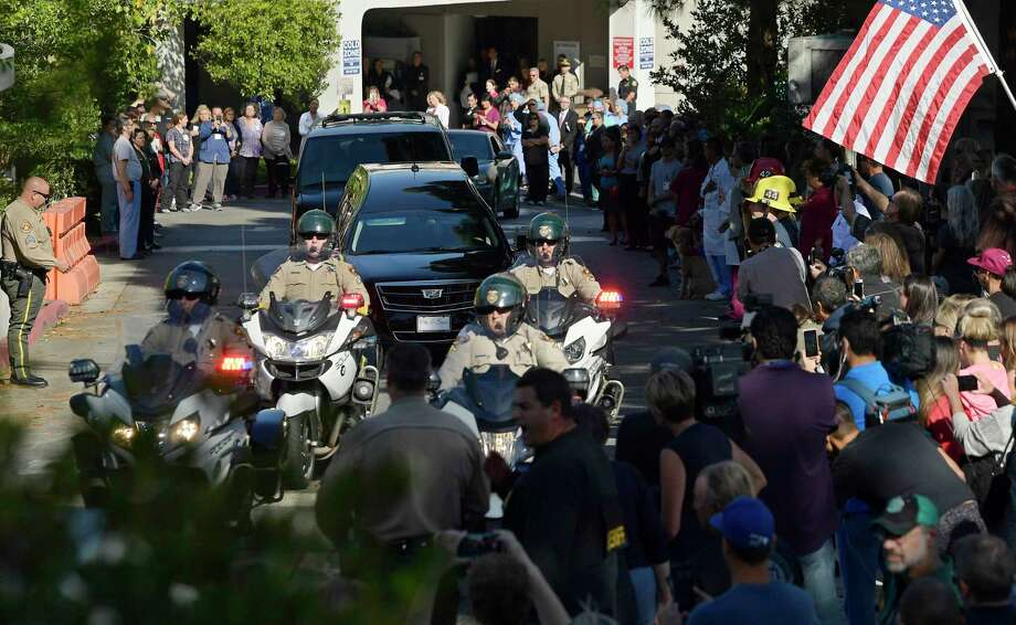 A law enforcement motorcade escorts the body of Ventura County Sheriff's Department Sgt. Ron Helus from the Los Robles Regional Medical Center Thursday, Nov. 8, 2018, in Thousand Oaks, Calif., after a gunman opened fire Wednesday night inside a country music bar killing multiple people including Helus. (AP Photo/Mark J. Terrill) Photo: Mark J. Terrill / Copyright 2018 The Associated Press. All rights reserved.