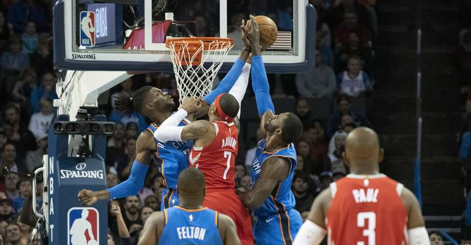 OKLAHOMA CITY, OK - NOVEMBER 8: Nerlens Noel #3 of the Oklahoma City Thunder and Patrick Patterson #54 of the Oklahoma City Thunder block Carmelo Anthony #7 of the Houston Rockets as he tries to shoot two points during the first half of a NBA game at the Chesapeake Energy Arena on November 8, 2018 in Oklahoma City, Oklahoma. NOTE TO USER: User expressly acknowledges and agrees that, by downloading and or using this photograph, User is consenting to the terms and conditions of the Getty Images License Agreement. (Photo by J Pat Carter/Getty Images) Photo: J Pat Carter/Getty Images