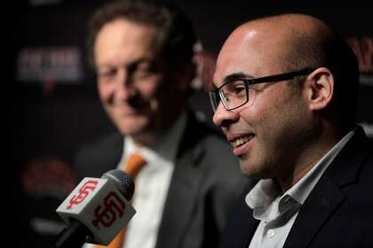 Farhan Zaidi answers a question after Giants CEO Larry Baer introduced him as the new president of baseball operations in 2018.