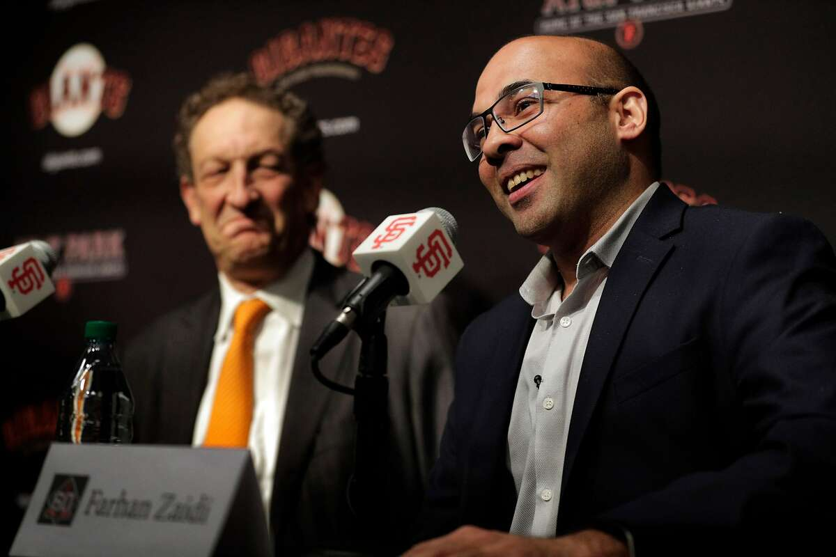 Giants CEO Larry Baer listens to Farhan Zaidi answer a question after he introduced Zaidi as the new president of baseball operations during a press conference at AT&T Park, in San Francisco, Calif., on Wednesday, November 7, 2018.