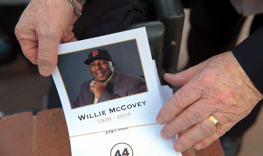 A member of the press takes a program during a public remembrance for Willie McCovey at AT&T Park in San Francisco, Calif., on Thursday, November 8, 2018. Photo: Carlos Avila Gonzalez / The Chronicle