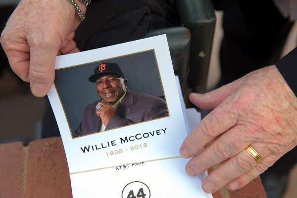 A member of the press takes a program during a public remembrance for Willie McCovey at AT&T Park in San Francisco, Calif., on Thursday, November 8, 2018.