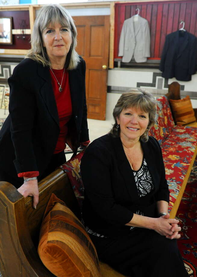 Mary Patridge-Brown (standing) and Roberta Sandler, co-directors of Grassroot Givers, are busy preparing for the 12th annual Day of Simple Giving on Nov. 17 at St. Sophia Greek Orthodox Church in Albany. (Times Union archive)