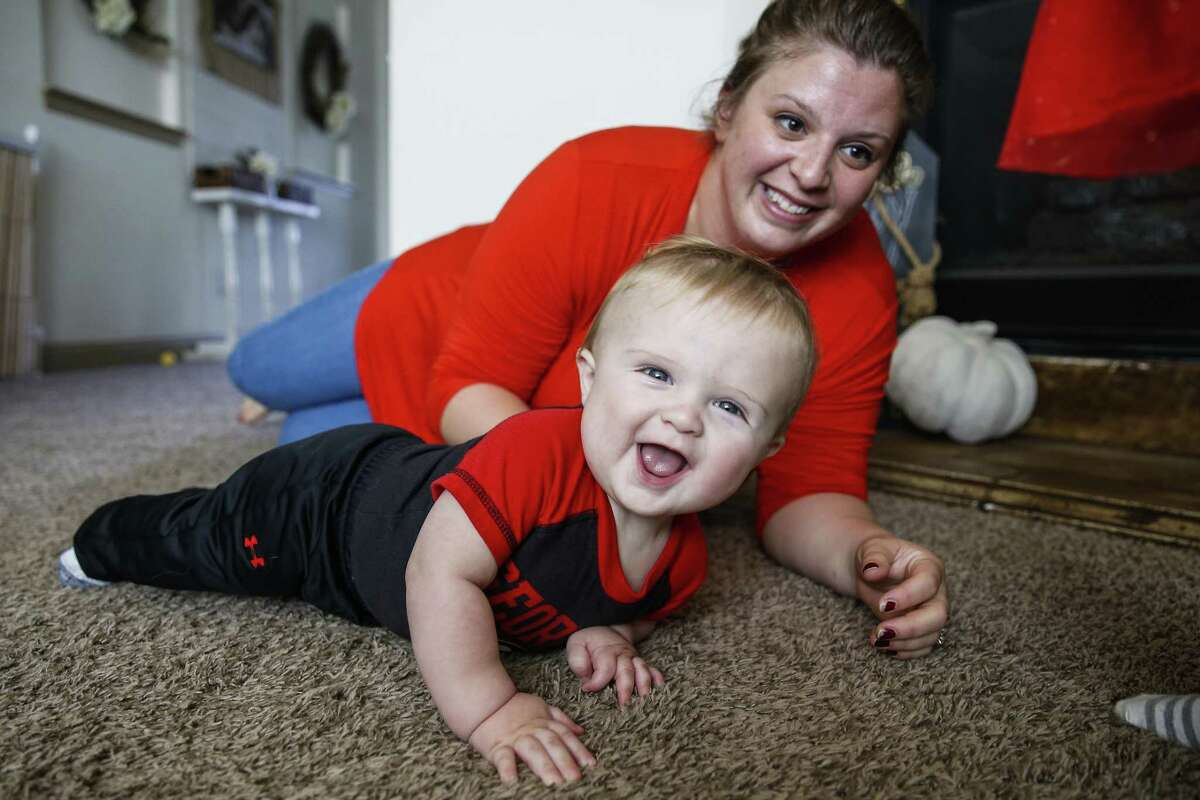 Melissa Bright plays with her nine-month-old son, Mason Bright, Saturday, Nov. 3, 2018, in Tomball.More photos of the family...