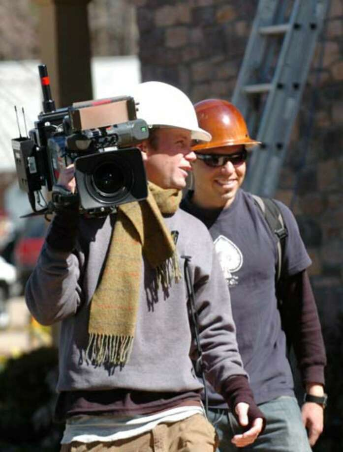 The video crew works on the scenes at the Oatman's new home on Wednesday, March 28. Photo: Cindy Schultz