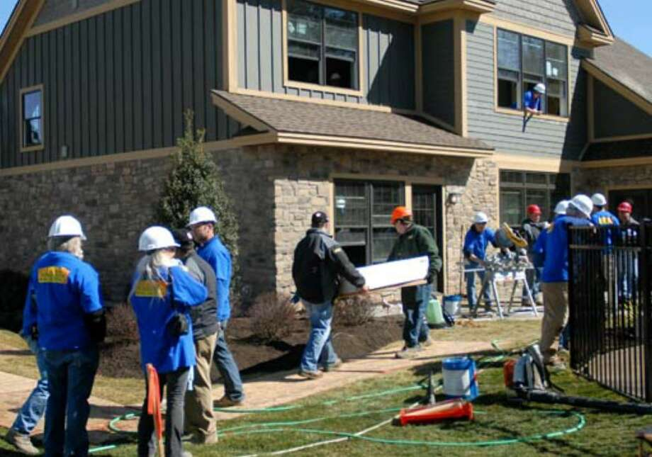 Work continues at the Oatman's new home on Wednesday, March 28. Photo: Cindy Schultz