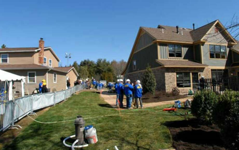 A view of Debbie Oatman's new home from the neighbor's backyard taken on Wednesday, March 28. Photo: Cindy Schultz