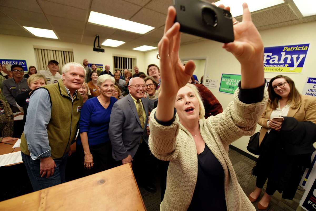 U.S. Sen. Kirsten Gillibrand takes a selfie with fellow Democratic candidates, including; Judge Peter Lynch, Pat Strong and U.S. Rep. Paul Tonko, while while meeting with volunteers at the Albany Democratic Committee headquarters on Monday, Nov. 5, 2018, in Albany, N.Y. (Will Waldron/Times Union)