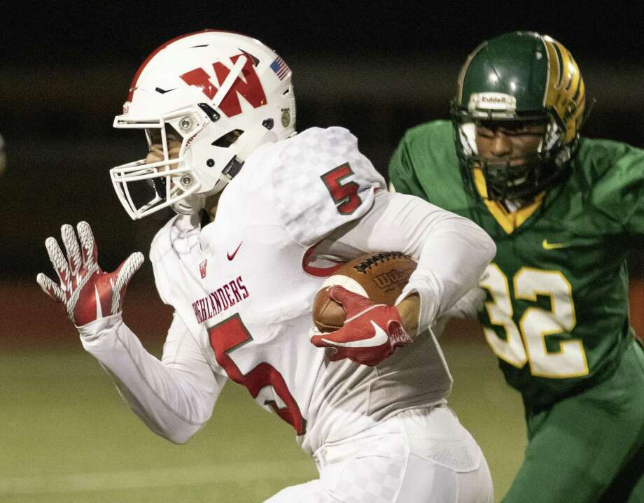 he Woodlands running back Bryeton Gilford (5) breaks past Klein Forrest defensive back Otis Berry (32) during a District 15-6A game Thursday, Nov. 8, 2018 at Klein Memorial Stadium. Photo: Cody Bahn, Houston Chronicle / Staff Photographer / © 2018 Houston Chronicle